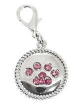 Swarovski Paw Dog Collar Charm (Pink Crystals) - A charm to remind you who really is the Boss, it's the little girl with the four legs! The paw is make up of 8 pink Swarovski Crystals set in a silver alloy fob with roped edging. Attaches to any collar's D-ring with a lobster clip. Measures approx. 1'' / 2.5cm wide.