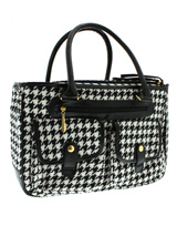 Houndstooth Pet Carrier - A classic Houndstooth design Pet Carrier but with up to the minute styling. Designer fabrics and trims combine to create a chic carrier fit to show off your pet while complementing your wardrobe. The Houndstooth carrier is specifically designed to make your pet's journey as comfortable and as safe a...