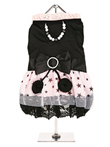 Midnight Stars Dress - Step out in style in this beautiful dress. Made from highest quality material with two tiers of delicate white chiffon skirting and one tier of pink satin printed with black stars finished with a black lace hem.  As a finishing touch a beautiful black satin bow surrounds the waist. The bow is tied w...